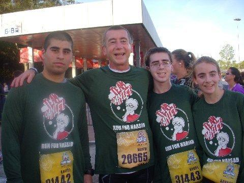 Team Daniel: Dr. Robert Laitman, second from left, and his son, Daniel, in glasses, at a recent half-marathon. Flanking them are Daniel's cousin Joey and sister Hannah.