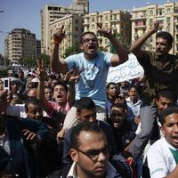 """Egyptians shout anti- Mubarak slogans during their protest at Tahrir Square in Cairo, Egypt, April 10, 2011. Former Egyptian President Hosni Mubarak is denying that he abused his authority to amass wealth and property in his first speech since his ouster. Arabic reads """"we need our money from Mubarak."""" (AP)"""