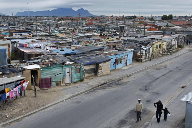 People walk in the impoverished township of Khayelitsha situated on the outskirts of Cape Town, South Africa. (AP)