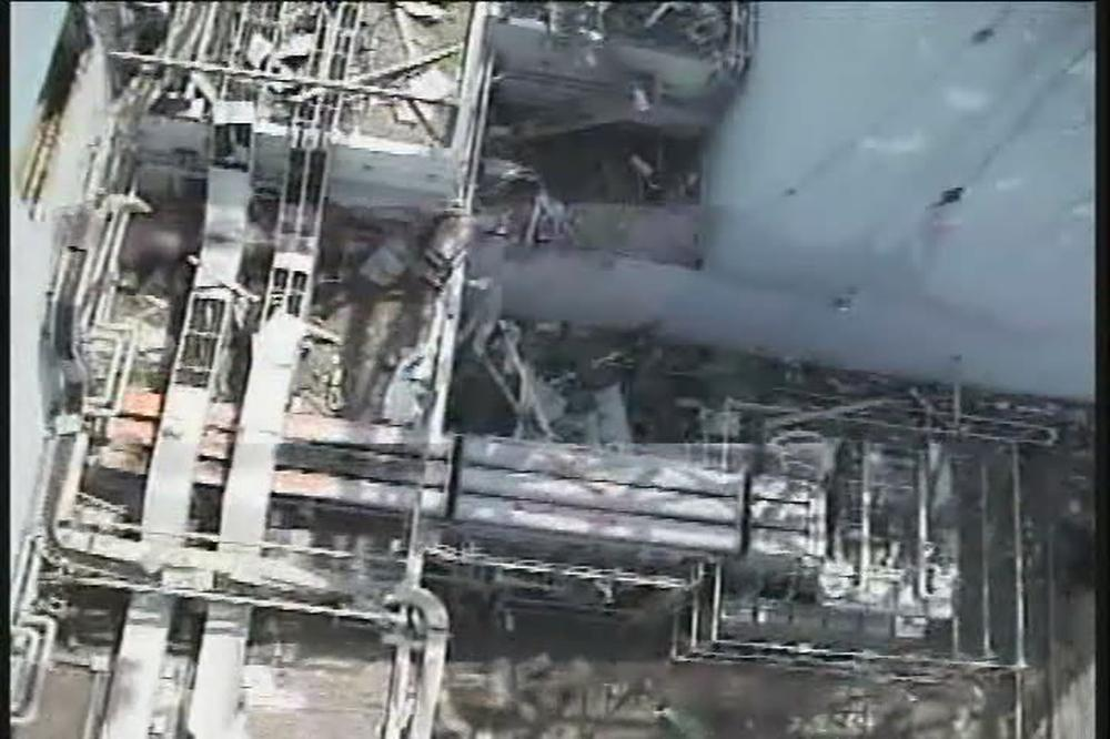 The north side of the damaged reactor building of Unit one at the Fukushima Dai-ichi nuclear power plant in Okuma town, Fukushima Prefecture, northeastern Japan.  (AP)