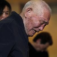 A man expresses his feeling during a memorial service for the March 11 earthquake victims at Flora Memorial Hall in Soma, Fukushima Prefecture, northeastern Japan. (AP)