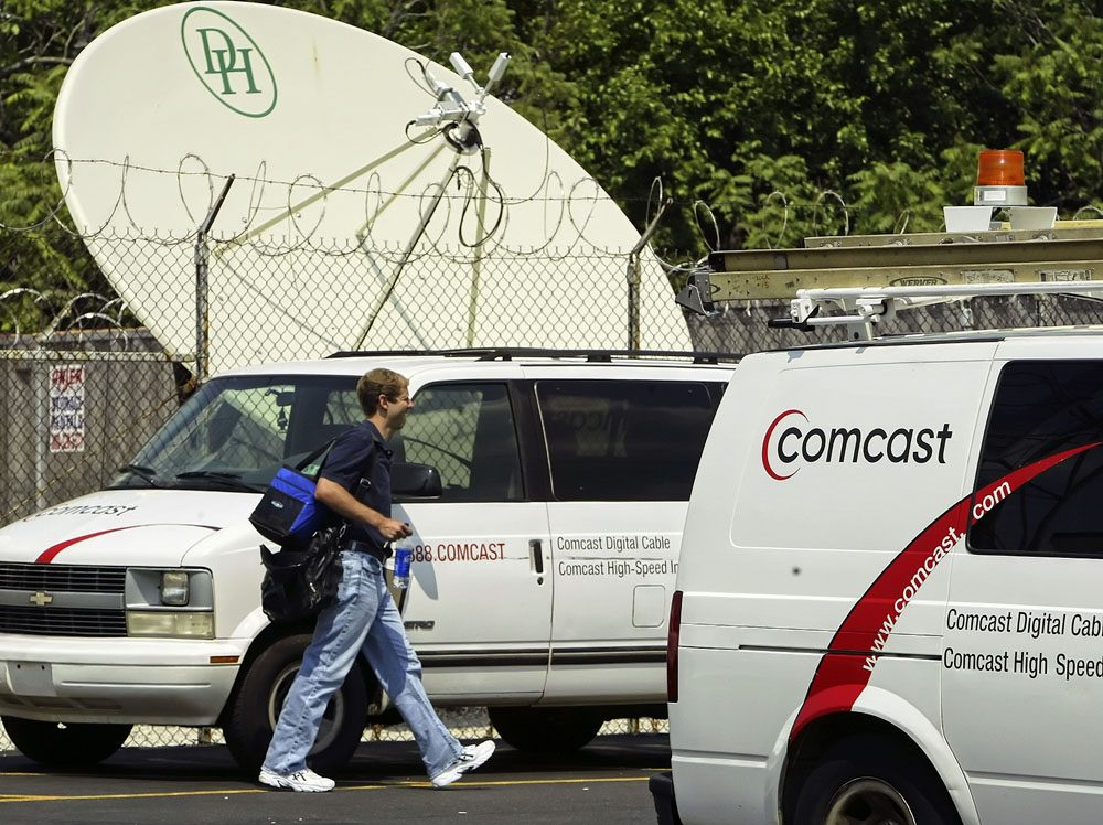 Comcast, the nation's largest cable television operator, at work (AP)