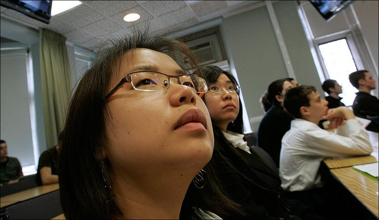Asian-American students watch a news report during a class at Lehigh University in Pennsylvania. (AP)