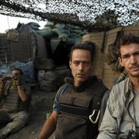 """Directors and journalists Sebastian Junger, left, and Tim Hetherington are shown at the Restrepo outpost in the Korengal Valley, Afghanistan, during the filming of their documentary  """"Restrepo"""". Hetherington was recently killed while reporting from Libya. (AP/Outpost Films/Tim Hetherington)"""