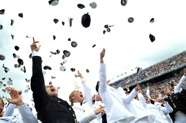 Newly commissioned officers from the U.S. Naval Academy class of 2010 celebrate the conclusion of their graduation and commissioning ceremony May 28, 2010 at Navy-Marine Corps Memorial Stadium in Annapolis, Md. (AP)