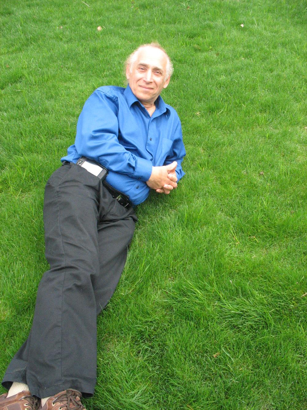 Jackson Madnick, the inventor of Pearls Premium grass seed, lays down on lawn seeded with his ultra low maintainence grass. (Photo by Monica Brady-Myerov)