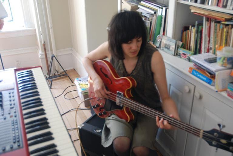 Naomi Yang plays her beloved bass. (Andrea Shea/WBUR)