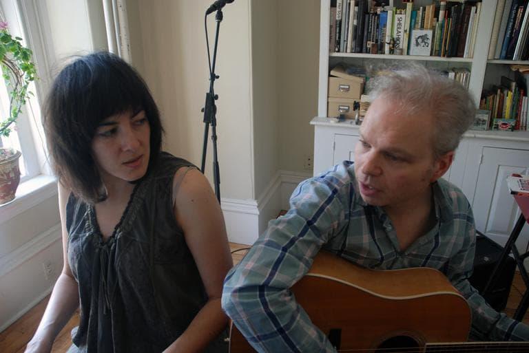 Naomi Yang and Damon Krukowski sing at their piano. (Andrea Shea/WBUR)