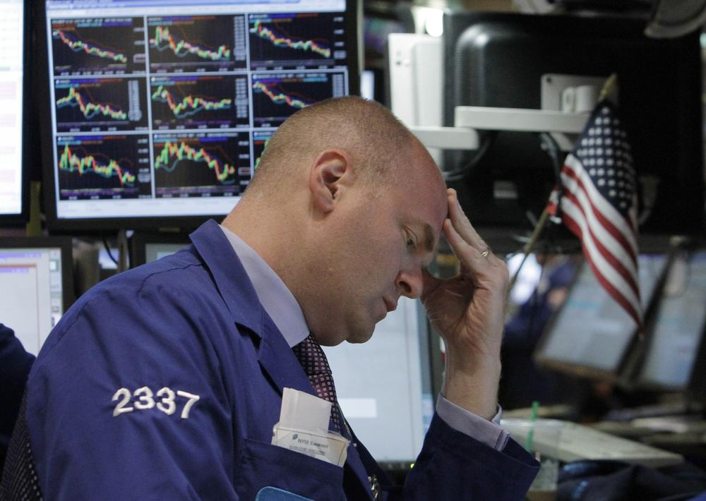 Specialists Evan Solomon works on the floor of the New York Stock Exchange Wednesday, June 1, 2011. Fears that the economy is stalling sent the Dow Jones industrial average down 280 points, erasing more than a quarter of the stock market's gains for the year. (AP)