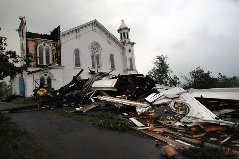 The steeple of The First Church of Monson lay in rubble on the ground after a tornado swept through the downtown area of Monson, Mass., Wednesday. (AP)