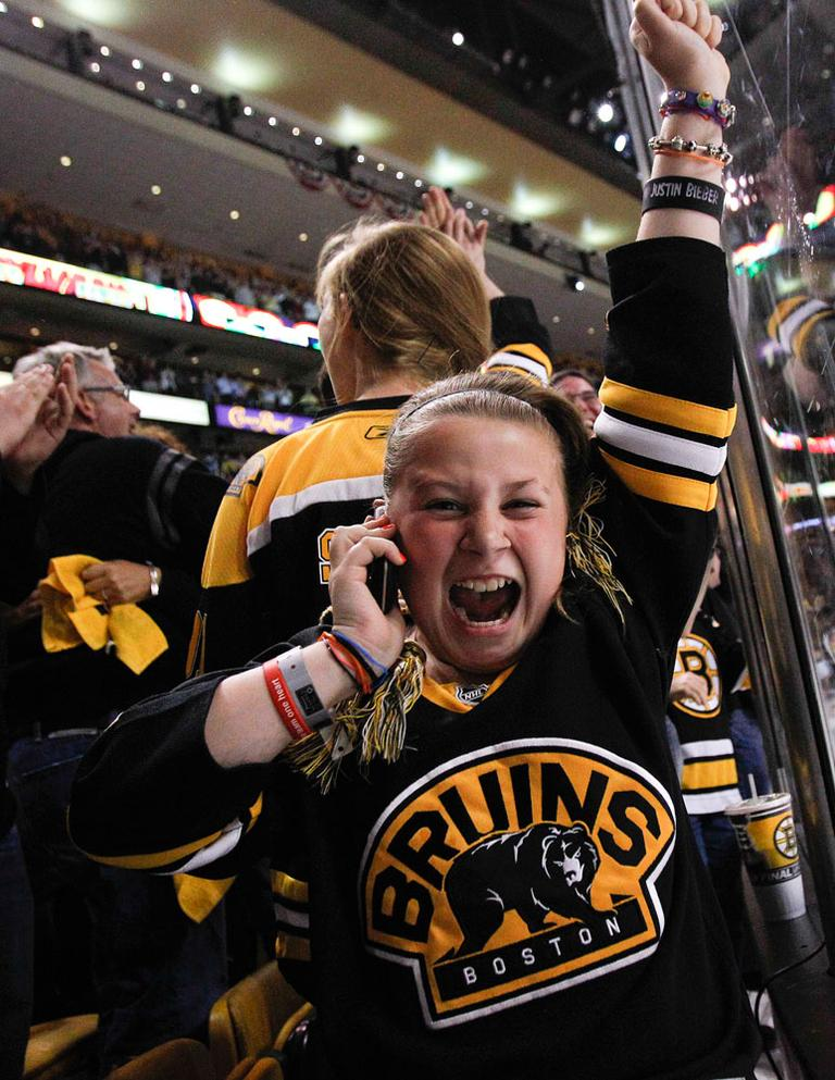 A Bruins fan reacts after Boston scored a fourth goal against the Canucks during Game 3 on June 6 in Boston. (AP)