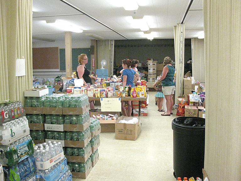 The basement of the First Congregational Church in Monson is laid out like a supermarket, so that tornado survivors can find what they need easily. (Fred Thys/WBUR)