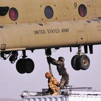 Soldiers from Combined Team Zabul sling-load a container of components for a cell phone tower on March 25, 2011, in Kandahar province. The American military is building an independent cell phone network in Afghanistan to prevent the Taliban from shutting down cell phone communication. (AP)