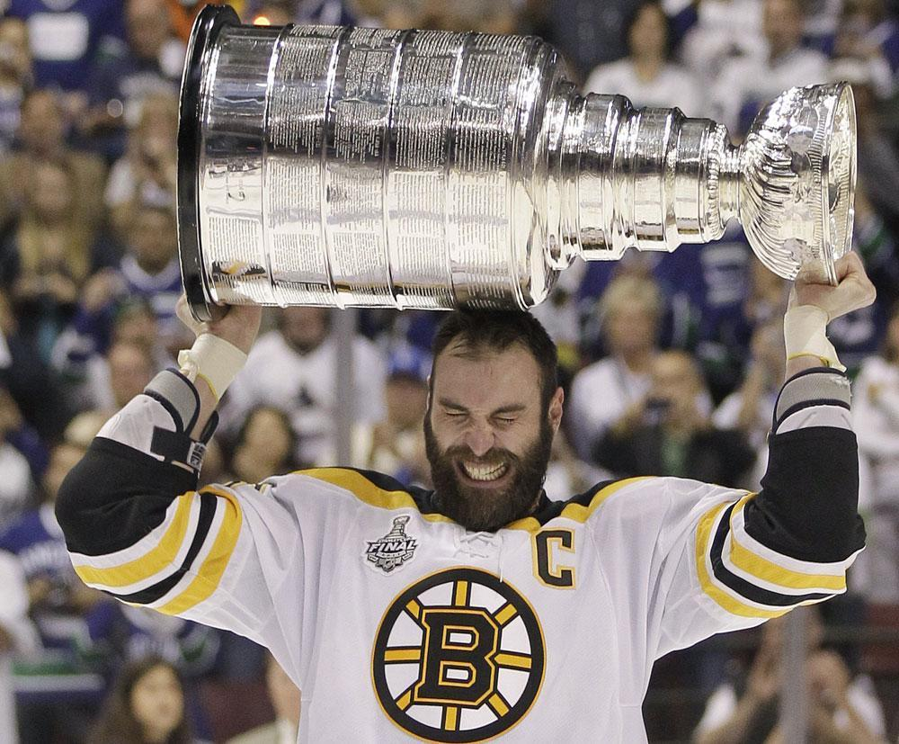 e88c6f13d23 Bruins captain Zdeno Chara hoists the Stanley Cup after his team finished  off the Canucks Wednesday