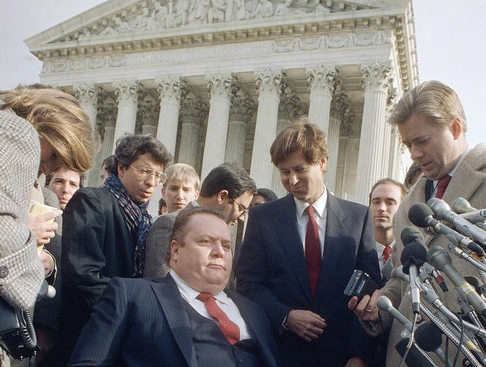 Sex magazine publisher Larry Flynt left the Supreme Court building in Washington, Dec. 3, 1987 after a court case for his magazine Hustler was heard.  The magazine later won. (AP)