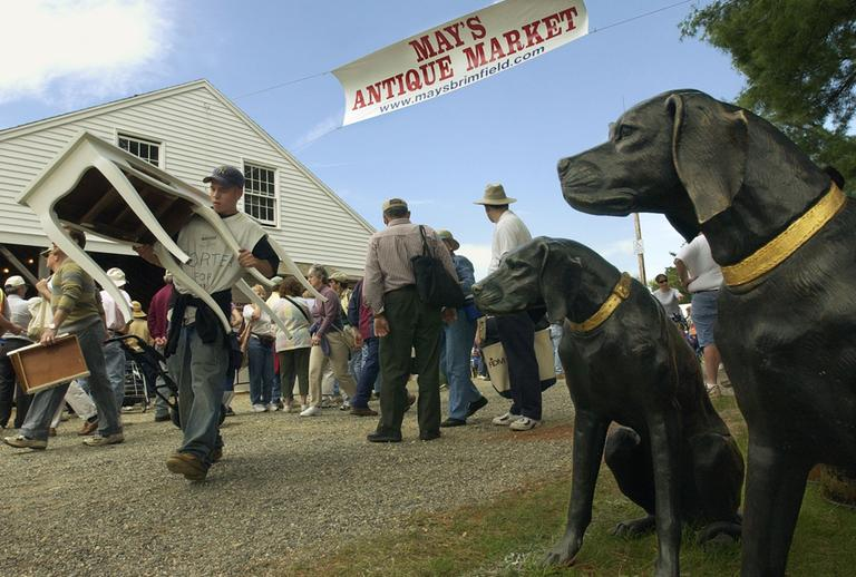 A pair of cast bronze hounds appear to stand guard at the Antique Market in Brimfield, Mass. (AP)