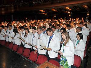 A med school class takes the Hippocratic Oath