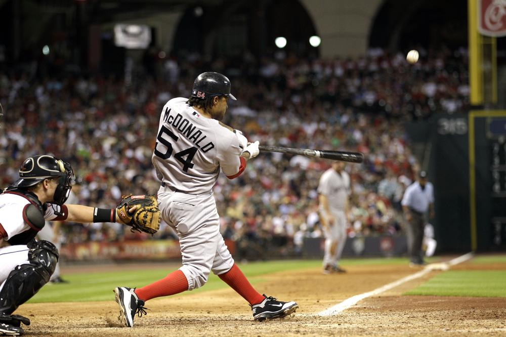 Boston Red Sox's Darnell McDonald hits a three-run home run during the eighth inning. (AP)