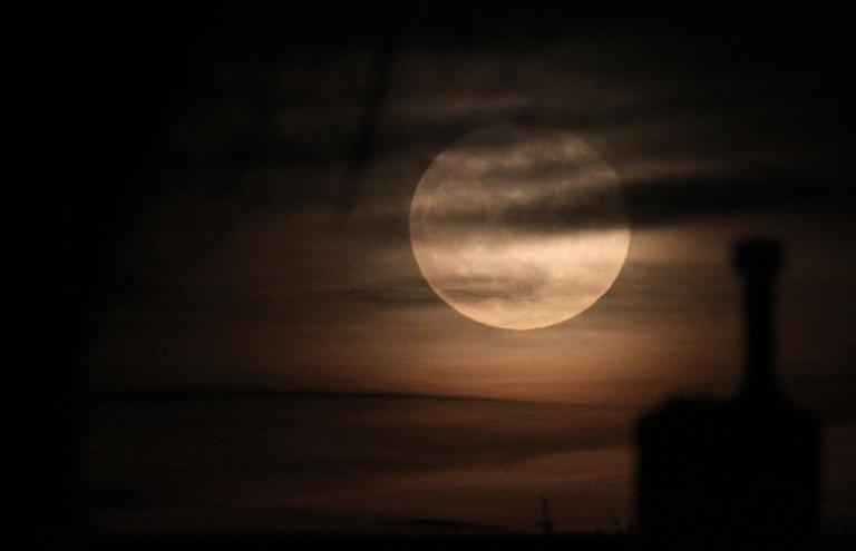 The transformation from human into a werewolf is often associated with the appearance of the full moon. (AP)