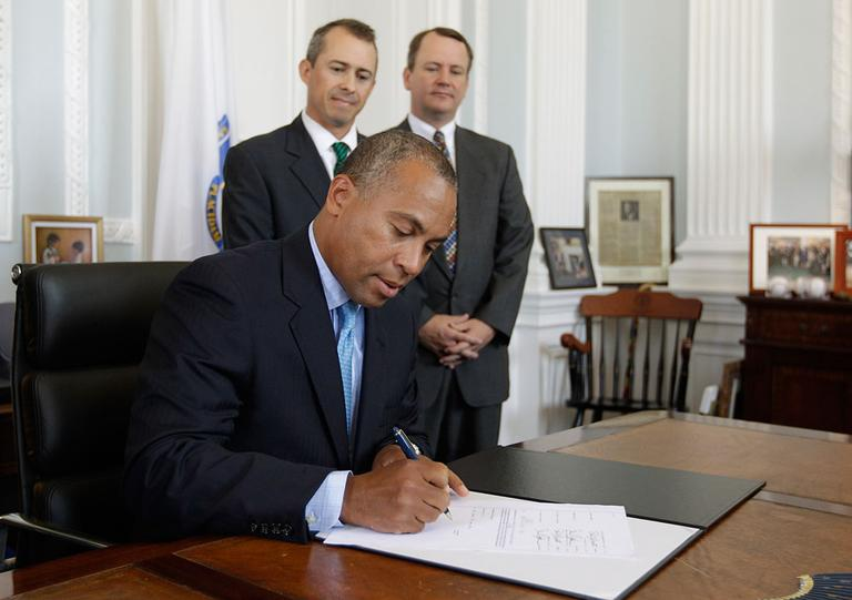 Gov. Deval Patrick signs the 2012 fiscal year budget in his office Monday. Looking on are Lt. Gov. Timothy Murray, right, and Secretary of Administration and Finance Jay Gonzalez. (AP)