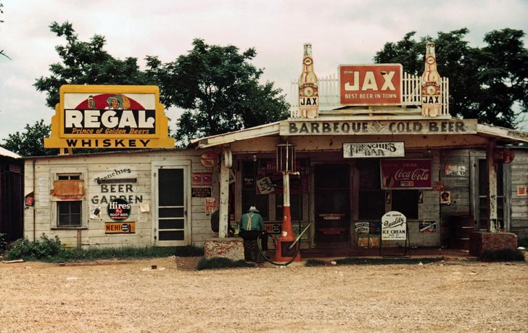 A crossroads business serves as store, bar, juke joint, and gas station in the cotton plantation area, Melrose, La., June 1940. (AP)