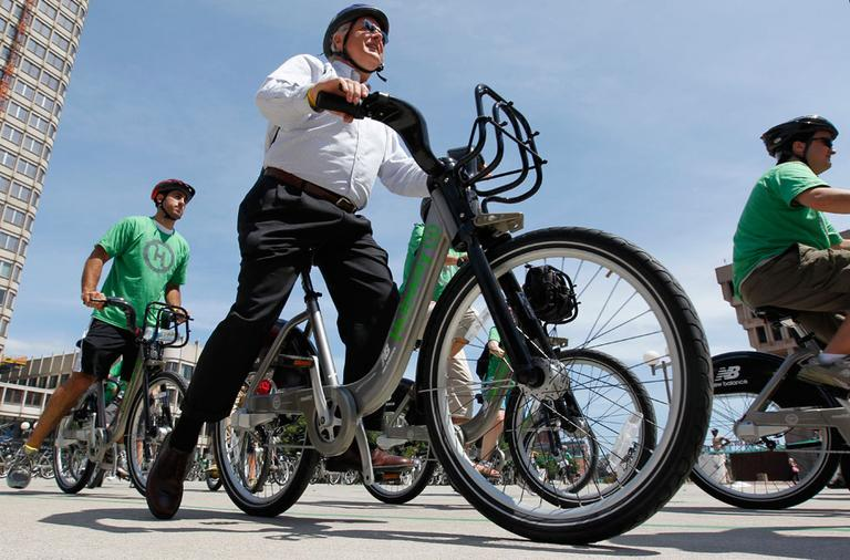 Cyclists depart Boston's City Hall Plaza Thursday as part of a launch of the state's first bike-share program. (AP)