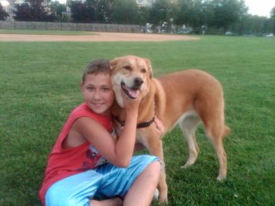 The author's son Nick, adopted from Russia, posing with Daisy