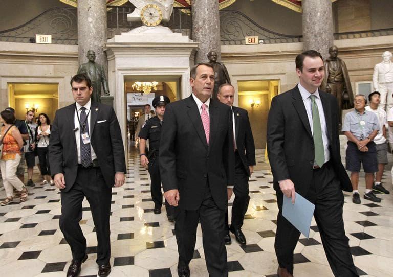 Rep. John Boehner, center, walked through Capitol Hill Monday. (AP)