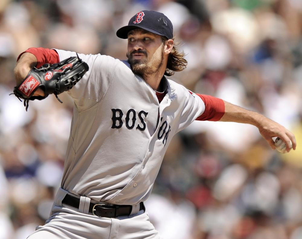 Boston Red Sox starter Andrew Miller delivers a pitch against the Chicago White Sox during the first inning of  the game in Chicago on Sunday. (AP)