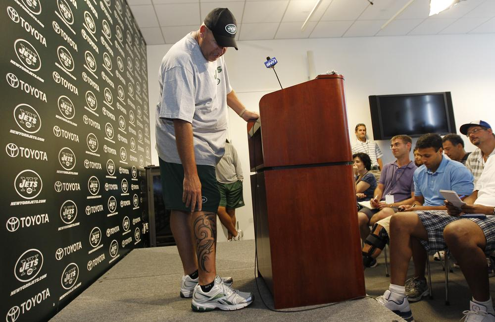 New York Jets head coach Rex Ryan points at his new tattoo during a press conference at Atlantic Health Training Center in Florham Park, N.J. (AP)
