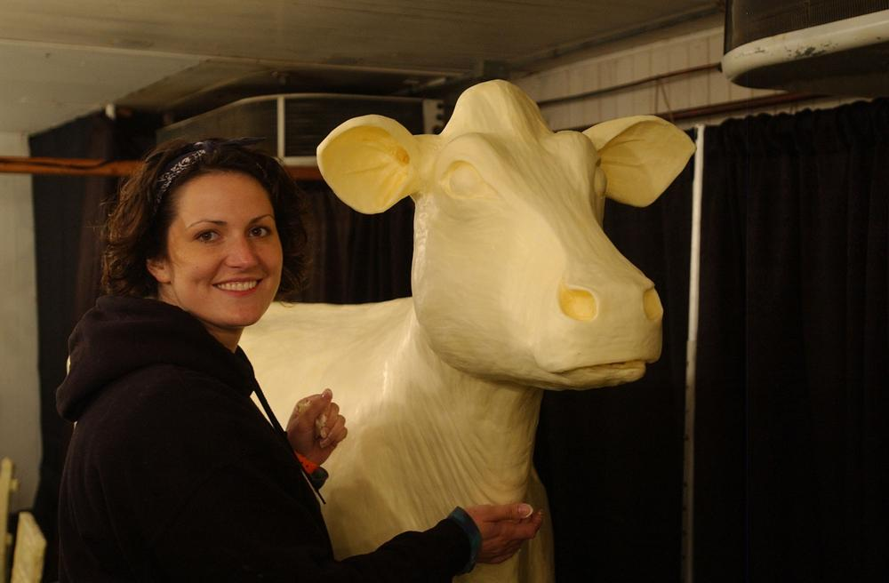 Sarah Pratt, current butter cow sculptor at the Iowa State Fair and her 2010 butter cow. (Courtesy Iowa State Fair)