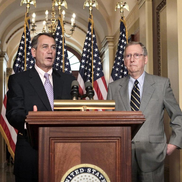 Speaker of the House John Boehner, R-Ohio, left, and Senate Republican leader Mitch McConnell of Kentucky, right, appear at a news conference about the debt crisis. (AP)