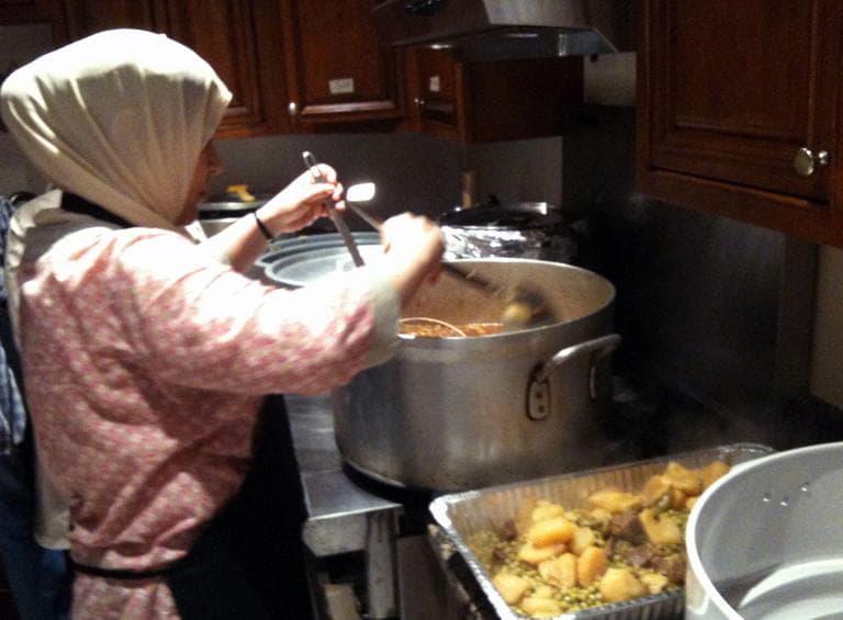 """Khadijah Sherif, 47, prepares """"iftar,"""" the meal that breaks the day-long fast for Ramadan. (Kimberly Adams/WBUR)"""
