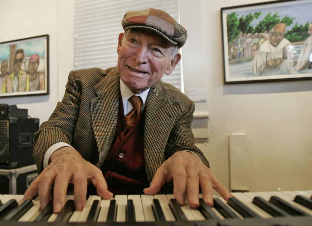 George Wein, founder and long-time producer of the Newport Jazz and Folk Festivals, playing jazz piano. (AP)