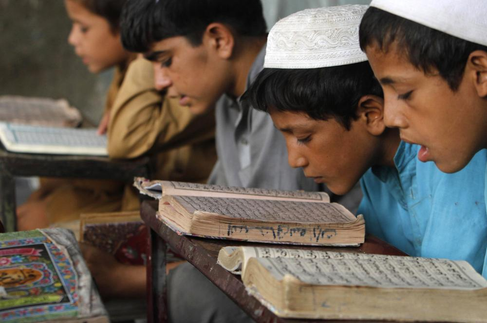 Afghan boys read the Quran during the Muslim holy month of Ramadan at a mosque in the city of Jalalabad, east of Kabul, Afghanistan. (AP)