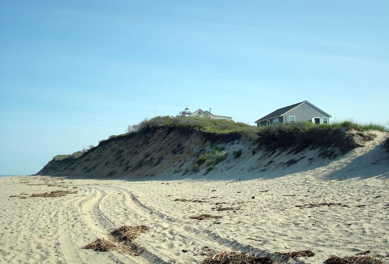 Statistically, the erosion seen here on Nauset Light Beach in Eastham will catch up to this house is about 10 years. (Adam Ragusea/WBUR)