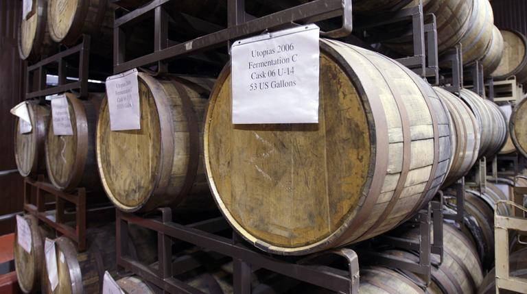 These aging hardwood barrels of the Utopias selection stacked in the barrel room of the Boston Beer Company, would not be brewed in Mass. under new rules by the state's Alcoholic Beverages Control Commission. (AP)