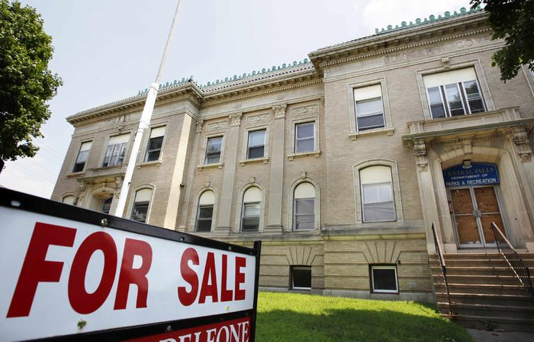 An old municipal building in Central Falls, R.I., is for sale on Tuesday as the town files for bankruptcy. (AP)