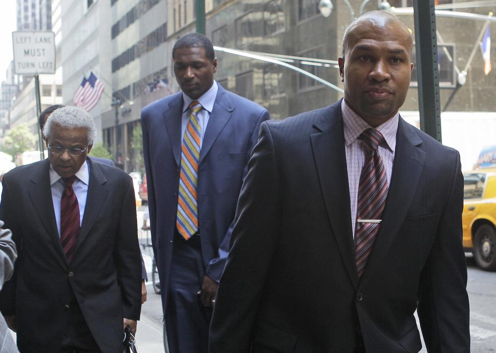 NBA Players Association president Derek Fisher arrives in New York for a meeting with the NBA, Monday. (AP)
