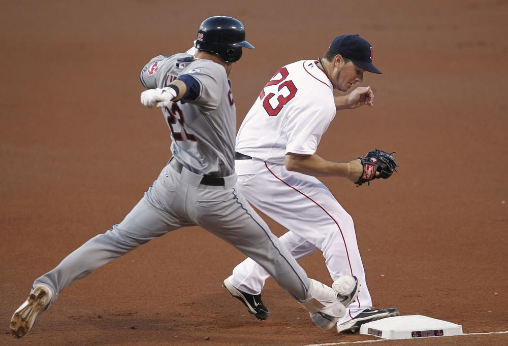 Boston Red Sox starting pitcher Erik Bedard beats Cleveland Indians' Jason Kipnis to first base for the out during the first inning of the game in Boston on Thursday. (AP)