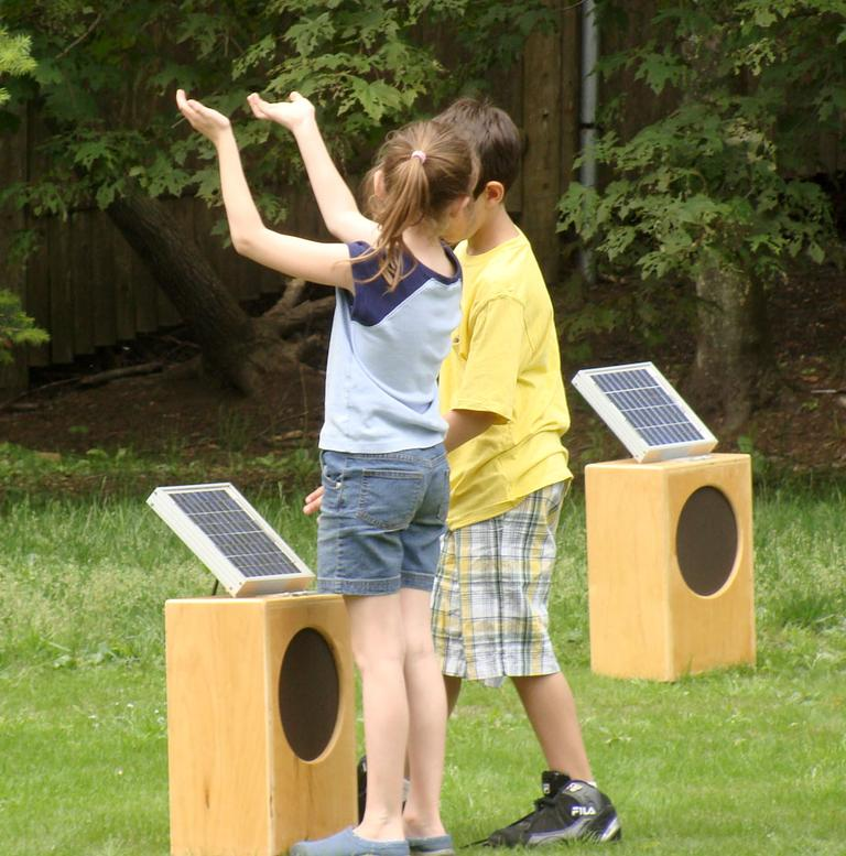 "Students from the Massachusetts School of Science, Creativity and Leadership tested the ""Sun Boxes"" installation. (Courtesy deCordova)"