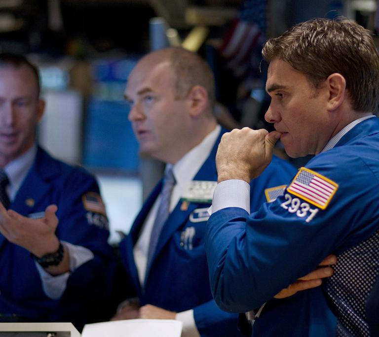 Traders work on the floor of the New York Stock Exchange on Thursday, Aug. 4, 2011 in New York. Stocks sank again early Thursday as investors continued to fret about the struggling economies in Europe and slow growth in the U.S. (AP)
