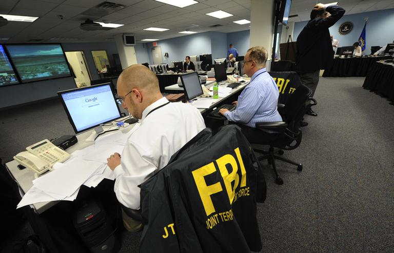 Agents from the FBI and other law enforcement agencies work at a 24-hour operations center at FBI headquarters in the Chelsea section of New York. (AP)