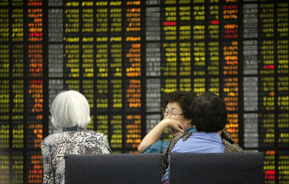 Asian stocks nose-dived Monday as the first-ever downgrade of the U.S. government's credit rating jolted the global financial system. (AP)