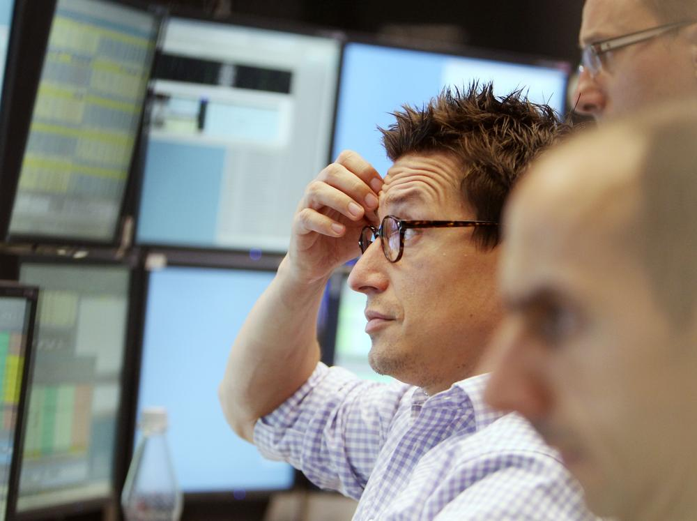 A trader watches his screens at the stock market in Frankfurt, Germany, Tuesday. (AP)