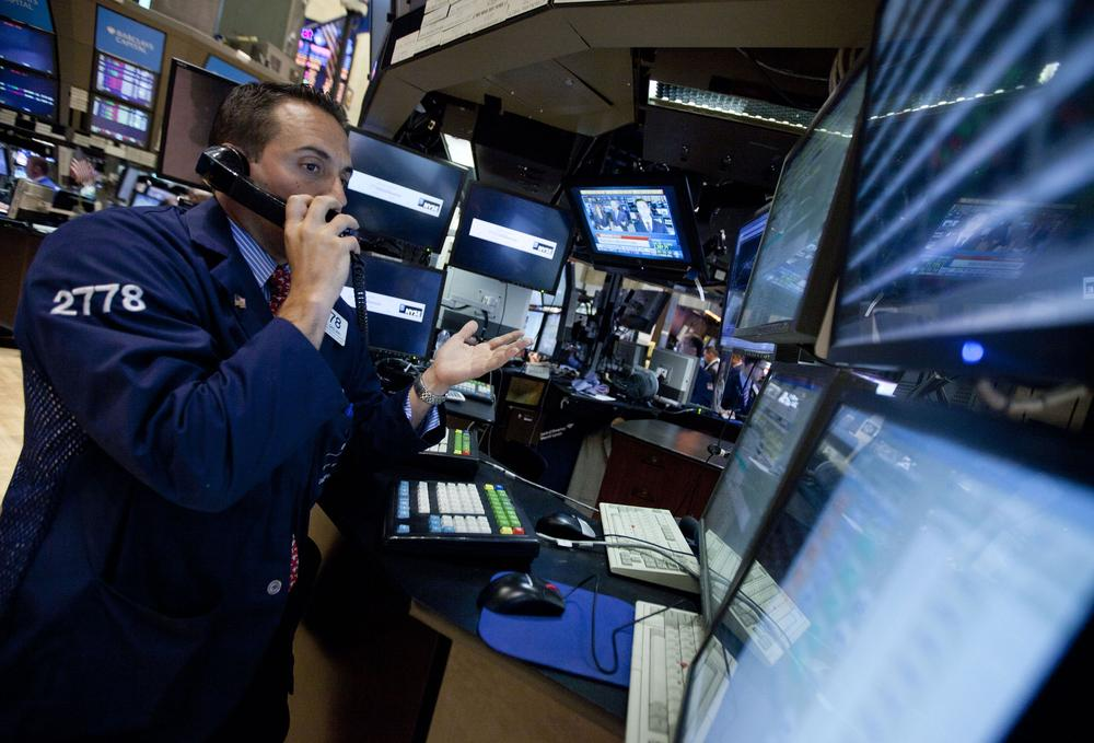 A trader works on the floor of the New York Stock Exchange before close on Monday in New York. (AP)