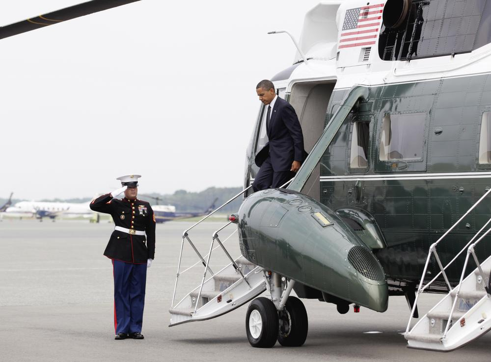 President Obama steps off of Marine One at Dover Air Force Base, Del., to pay tribute to 30 fallen soldiers. (AP)