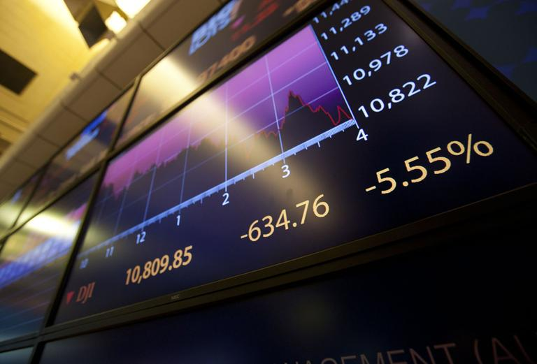 An electronic monitor displays the Dow Jones Industrial Average on the floor of the New York Stock Exchange near the close on Monday, Aug. 8, 2011. (AP)