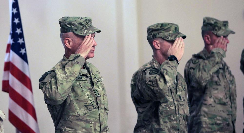 U.S Major General James L.Terry, left, and other soldiers  slaute during a transfer of command  ceremony in Kandahar airbase in Afghanistan. (AP)