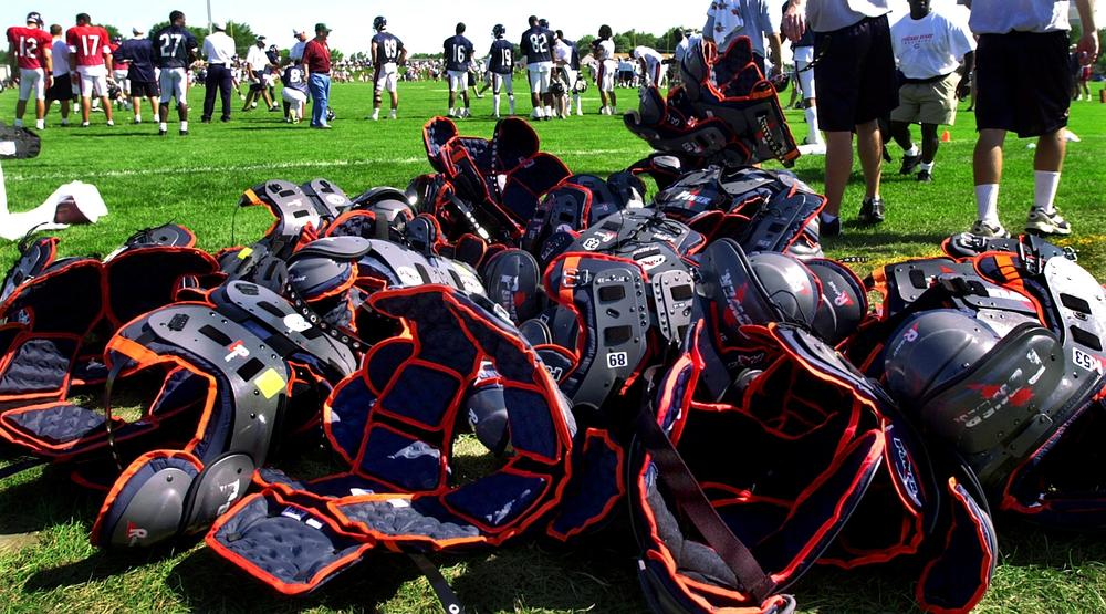 It's an NFL training camp tradition for rookies to carry veterans' shoulder pads off the field after practice. It's a ritual Bears receiver Roy Williams takes quite seriously. (AP)